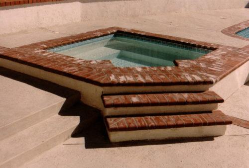 Cove Spa with concrete deck
