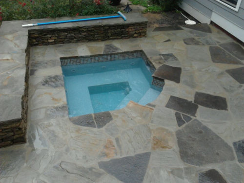 Cove Spa with stone deck