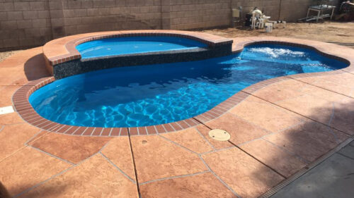 Round Tanning Ledge above pool with waterfall edge