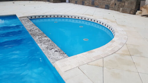 Round Tanning Ledge attached with pool
