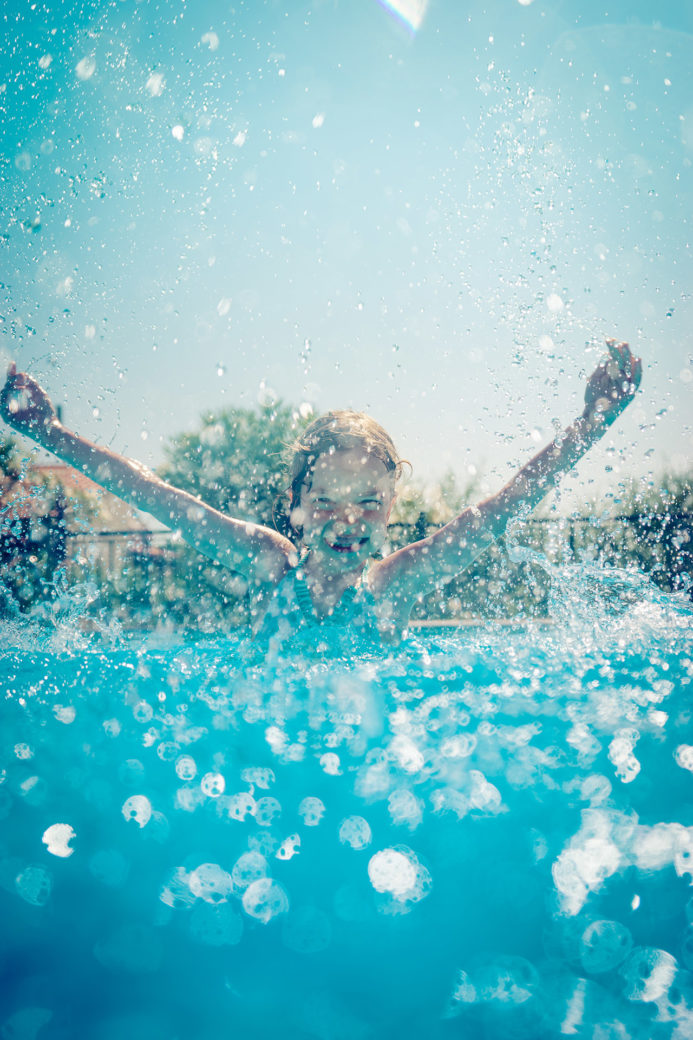 Child splashing in a pool